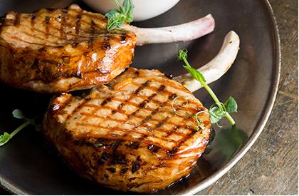 Photo de la recette de Côtelettes de porc Nagano laquées à l'orange et à l'érable