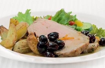Photo de la recette de Rôti de porc aux agrumes et aux olives