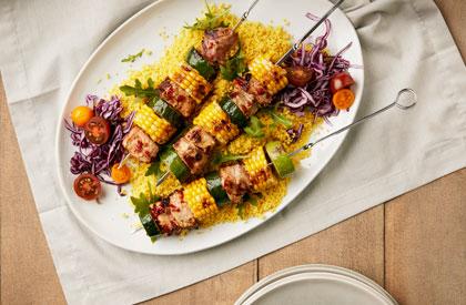 Photo de la recette de Brochettes de porc, courgettes et maïs