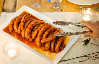 Photo de la recette de Saucisses de porc grillées et peperonata