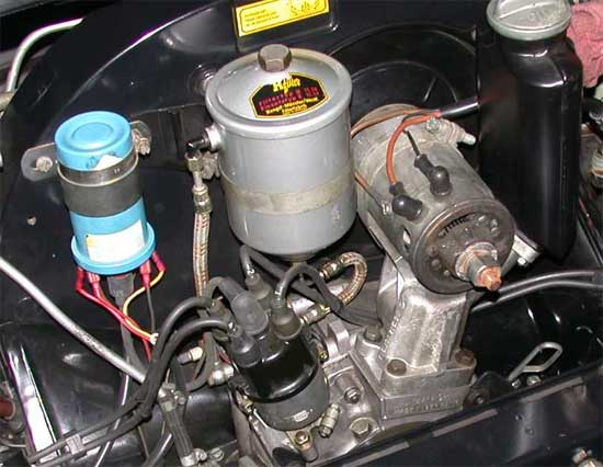 porsche356 a o. smith wiring-diagram remove the coil, then the oil filter the nuts that hold the coil are on the front side of the fan shroud don't drop them, or their big flat washers