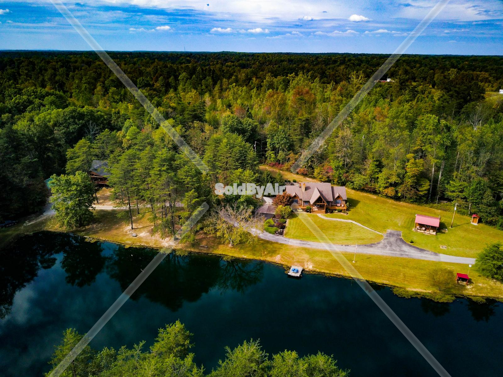 Drone Photo of A dreamy lake house on a summer day. in Jeffersonville Indiana