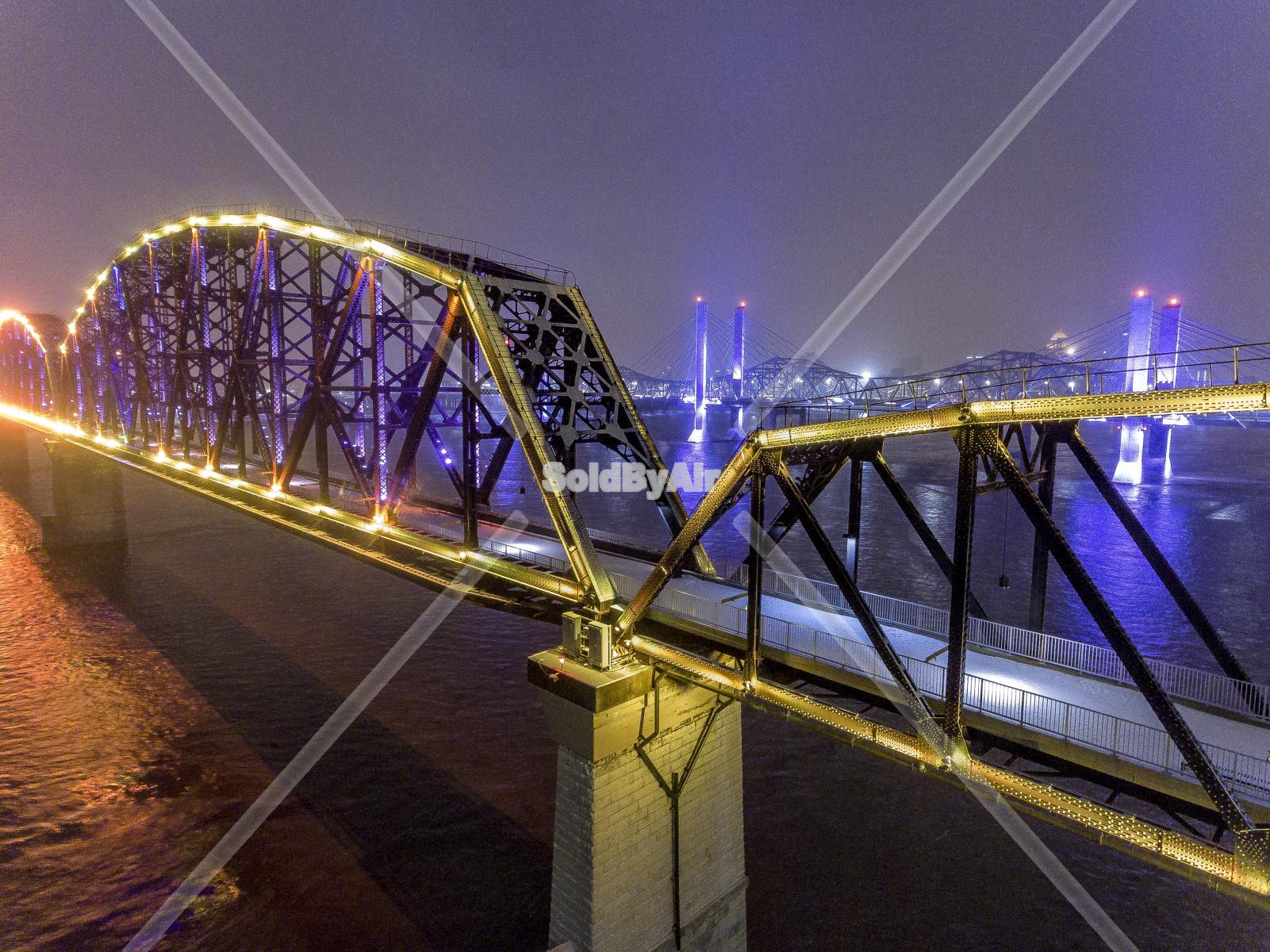 Drone Photo of Big Four Bridge and Abraham Lincoln Bridge lit up  in Louisville Kentucky