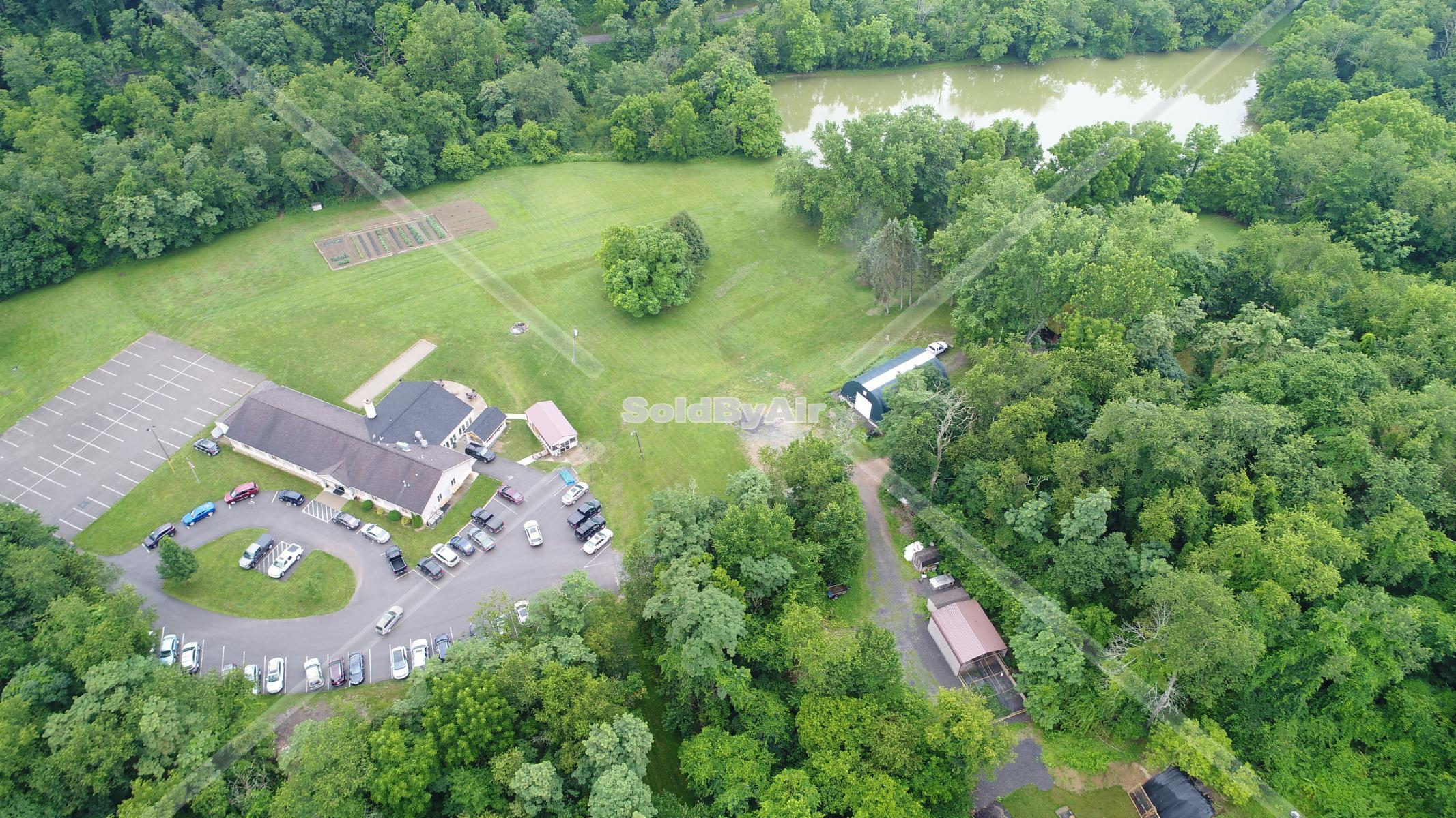 Drone Photo of Clubhouse and Lake at Alpine H&F Club in Bridgeville Pennsylvania