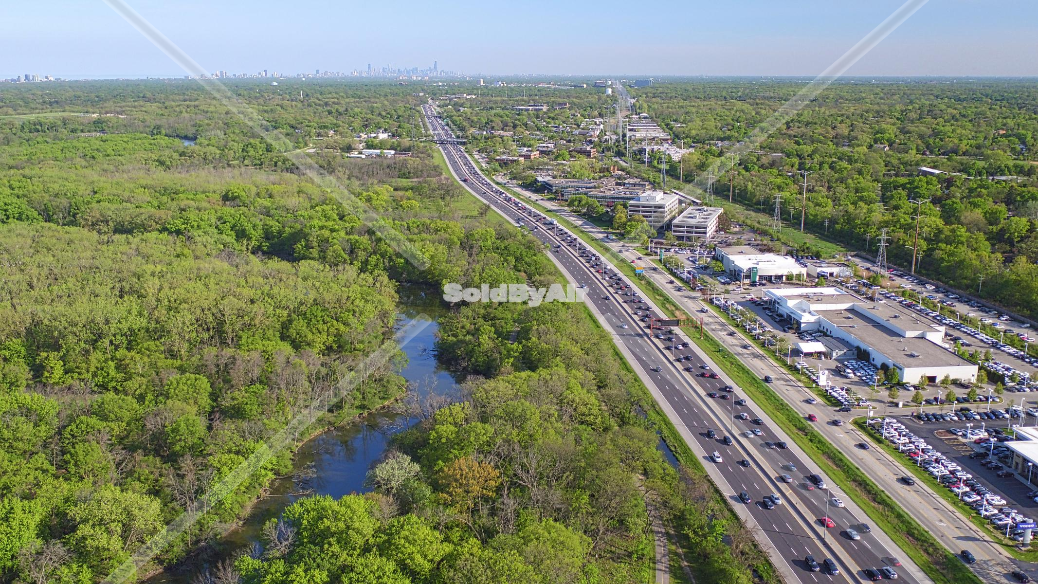 Drone Photo of Edens Expressway with Chicago skyline in distance in Northfield Illinois