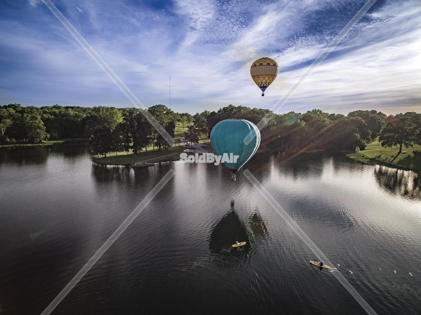 Drone Photo of Hot Air balloons flying over a lake in Louisville Kentucky