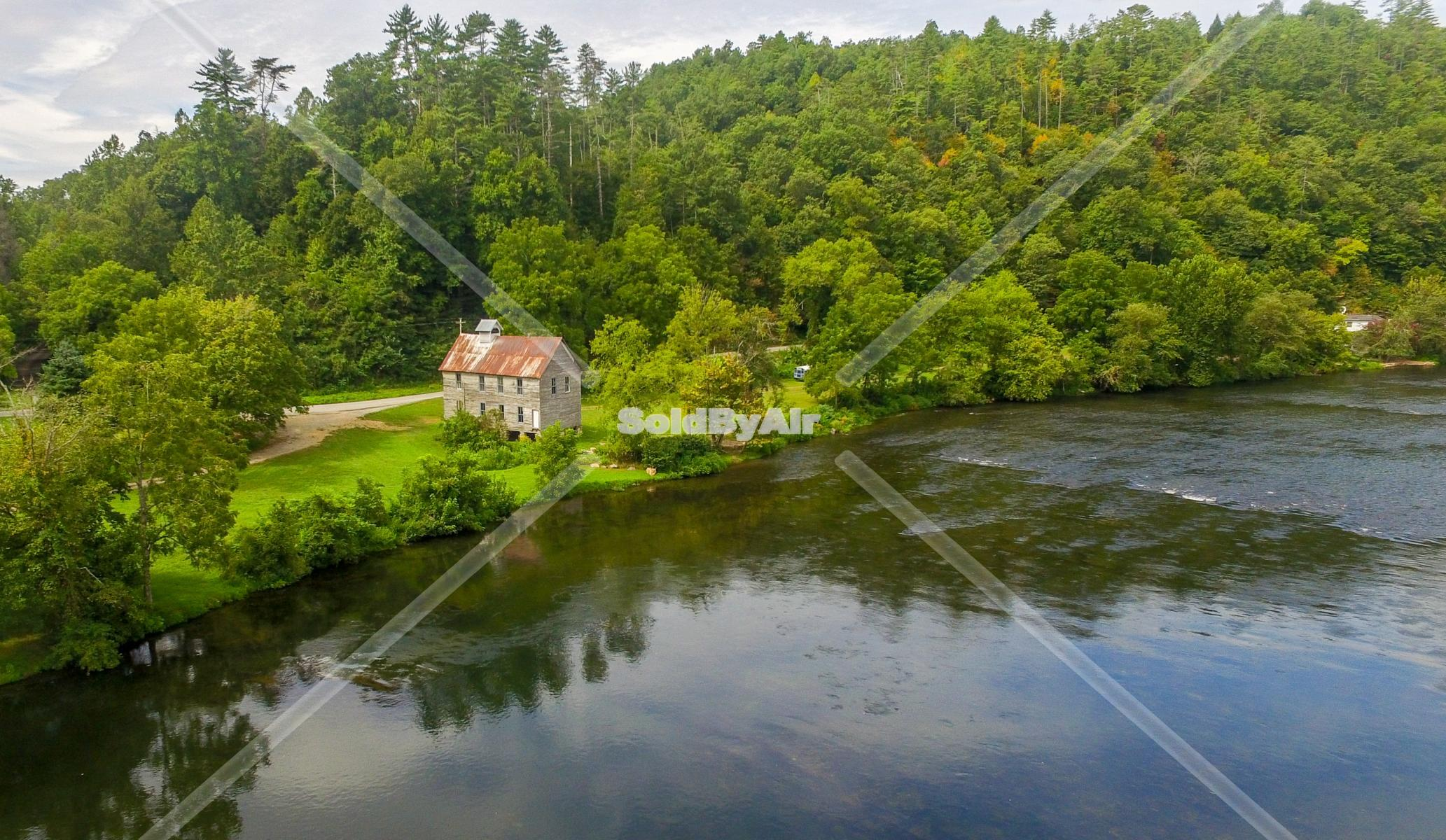 Drone Photo of Old schoolhouse on Hiawassee River. in Reliance Tennessee