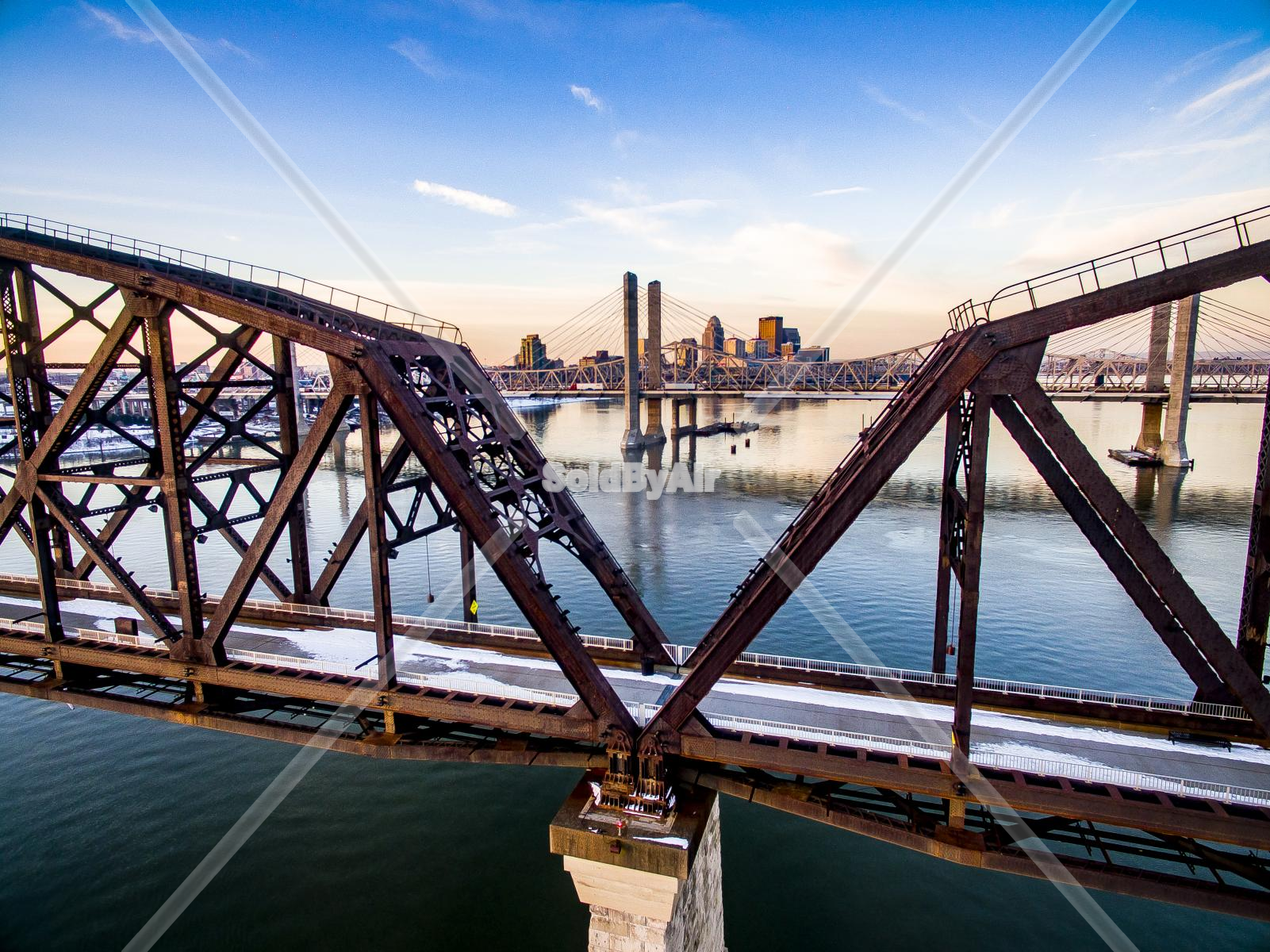Drone Photo of Winter aerial of city behind bridge in Louisville Kentucky