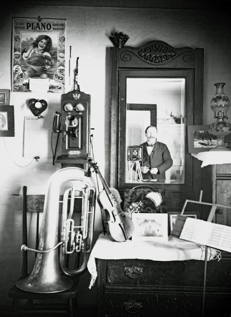Tillman self portrait with trombone and violin