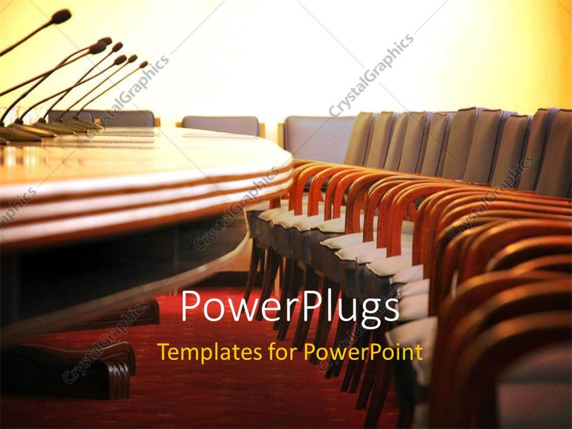 PowerPoint Template Displaying Conference Room with Microphones and Empty Wooden Chairs
