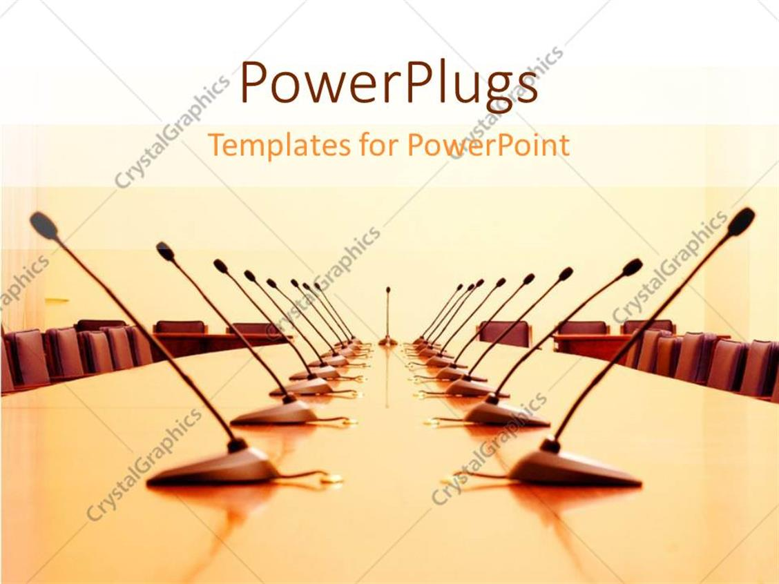 PowerPoint Template Displaying a large Conference Room with Many Chairs and Microphones