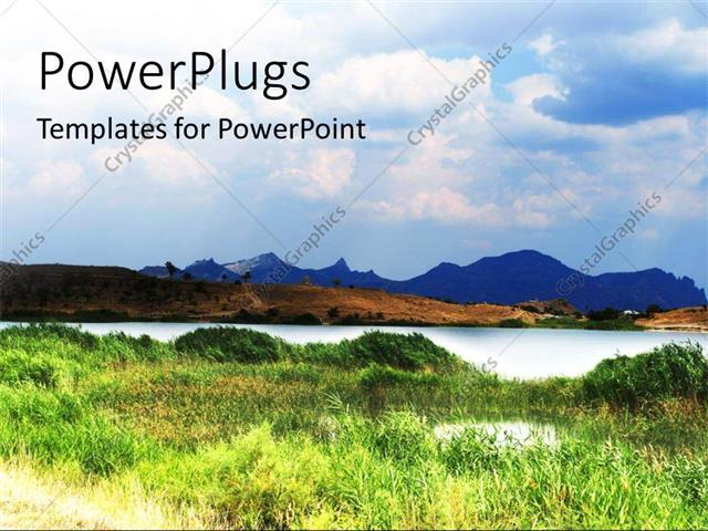 PowerPoint Template Displaying an Open Grass Field with Mountains and a River