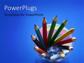 Colorful PPT theme having 12 well arranged pencils over a blue background