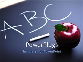 Presentation design featuring aBC written on blackboard with chalk and red apple sitting on board
