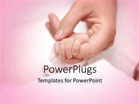 Audience pleasing presentation theme featuring an adult female hand holding a baby's hand on a pink surface