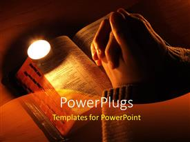 PPT theme with arms crossed in prayer on the Bible with the candle