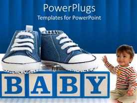 Presentation consisting of blue denim baby shoes on alphabet blocks