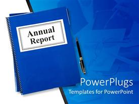 Beautiful PPT theme with blue notebook tagged Annual report with pen on blue table