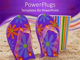 Presentation theme consisting of blue and purple floral patterned flip flops in sand with colorful cup