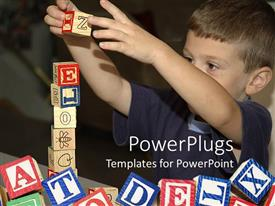 Amazing PPT layouts consisting of a child playing with various alphabetical blocks
