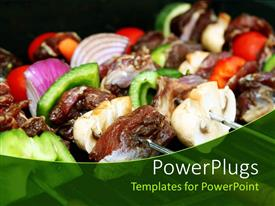 Presentation with close up of barbecue sticks with meat and vegetables, green pepper slices, onion slices, meat slices, small red tomatoes on BBQ grill