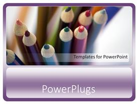 Colorful presentation theme having close up of colored pencils, colorful sharpened pencils on purple background