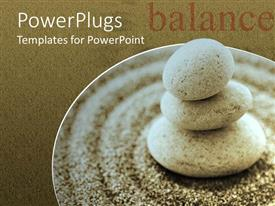 PPT theme consisting of a collection of zen stones along with sand grains with brown background