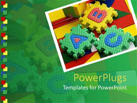 Theme consisting of colored ABC blocks on colorful surface in green background
