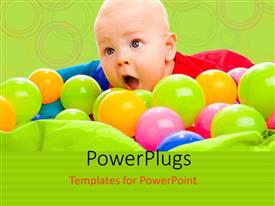Audience pleasing PPT theme featuring colorful balls surround happy baby boy in lying in basin