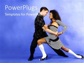 Amazing PPT theme consisting of a couple dancing with bluish background