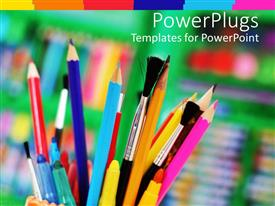 Beautiful PPT layouts with cup holding several paint brushes, pens, color pencils and markers