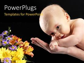 Slide deck consisting of cute baby safe in father's hands with flowers on black background