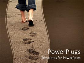 Audience pleasing PPT layouts featuring feet of a person leaving footprints on a beach on sandy background