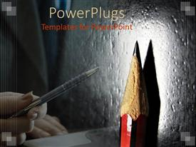 PPT layouts having feminine hand holding pen pointing to close up of spotlighted pencil point