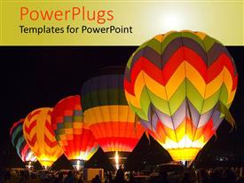 Presentation theme consisting of five colorful hot air balloons at night getting ready to take off