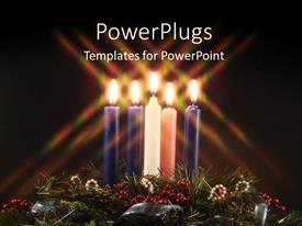 Amazing presentation design consisting of five lit multi colored candles on a black background