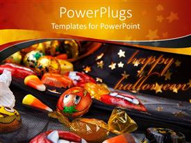 PPT layouts featuring halloween theme with scattered Halloween candies and chocolates on Wizard hat with orange and blue background