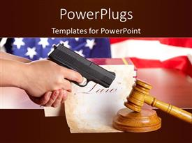 PPT layouts having hand with gun aiming at judges wooden gavel with gun and very old paper with US flag in the background