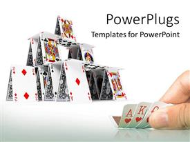 Colorful slide deck having hand holding playing cards with card house constructed on white background