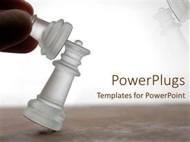 Elegant presentation theme enhanced with hand knocking down chess piece, game, competition