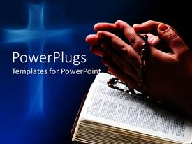 PPT theme featuring hands in prayer holding religious bracelet on open Bible book with abstract glowing cross on blue background