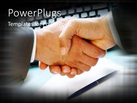 Beautiful PPT theme with handshake signifying business agreement with pen over paper and computer keyboard