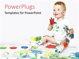 Colorful PPT theme having happy baby with paint on hands and face and body and painting on white floor