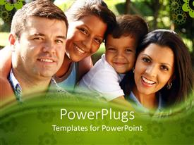 Audience pleasing presentation theme featuring happy family of four smiling as they pose for snapshot in park