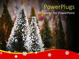Audience pleasing PPT theme featuring lots of Christmas trees with snow on two of them