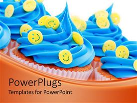 PPT layouts having lots of queen cup cakes with blue icing and yellow smiley faces