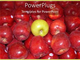 Presentation design having lots of red apples with a green one in the middle
