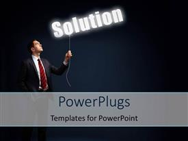 Beautiful PPT theme with a man holding the lighted word Solution over dark background