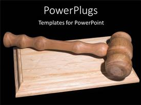 Slide set enhanced with nice wooden gavel on wooden surface with black background