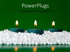 PPT theme featuring a number of candles with greenish background and place for text